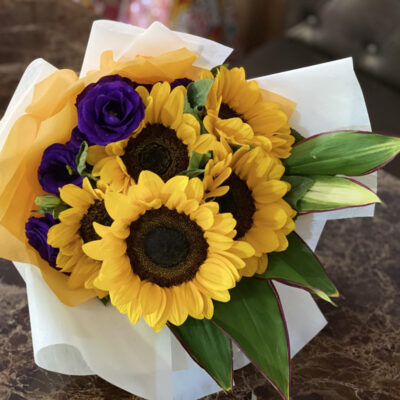 bouquet made of sunflowers and purple eustomas