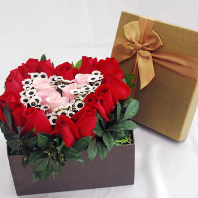 Heart shaped red roses in a box