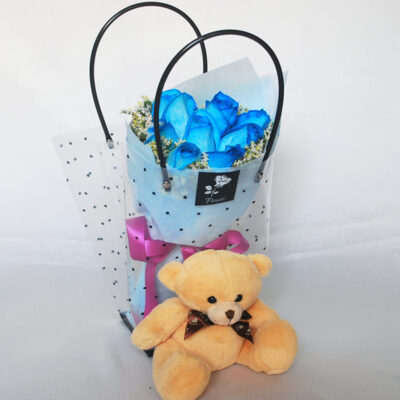 blue roses with bear in a bag