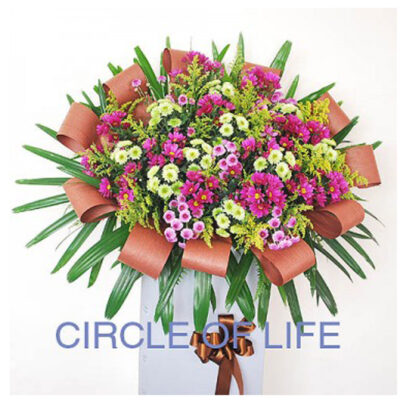 funeral-flowers-circle,lavender pom-poms, sparsely fitted with honey bracelet