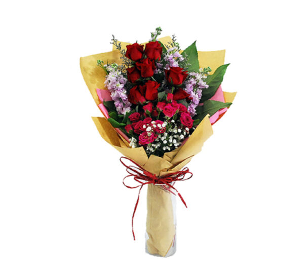hand-bouquet-chelsea, A classic red rose stands out in a pink rose bush