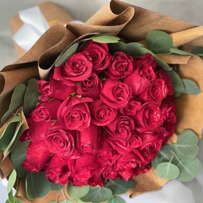 red roses in brown bouquet