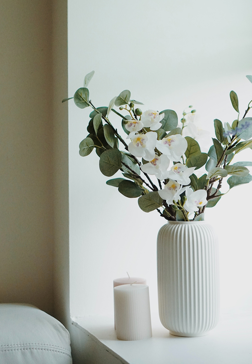 White flowers in a white ceramic pottery